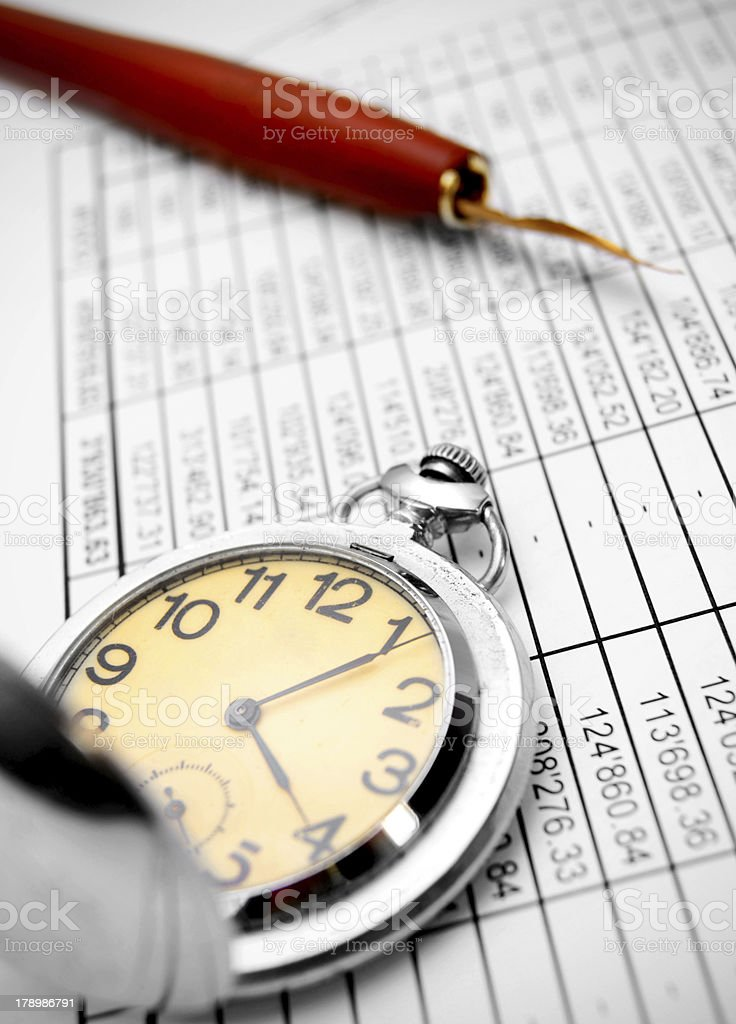 Watch and pen on documents. royalty-free stock photo