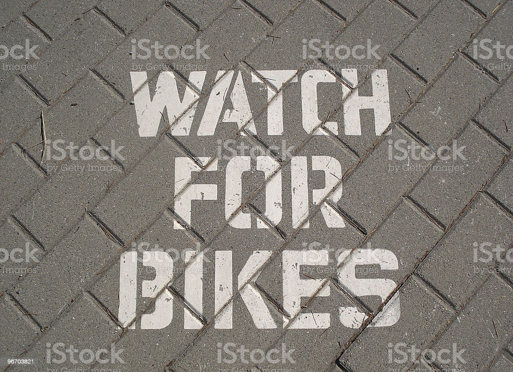 Watch for Bikes Painted Sign royalty-free stock photo