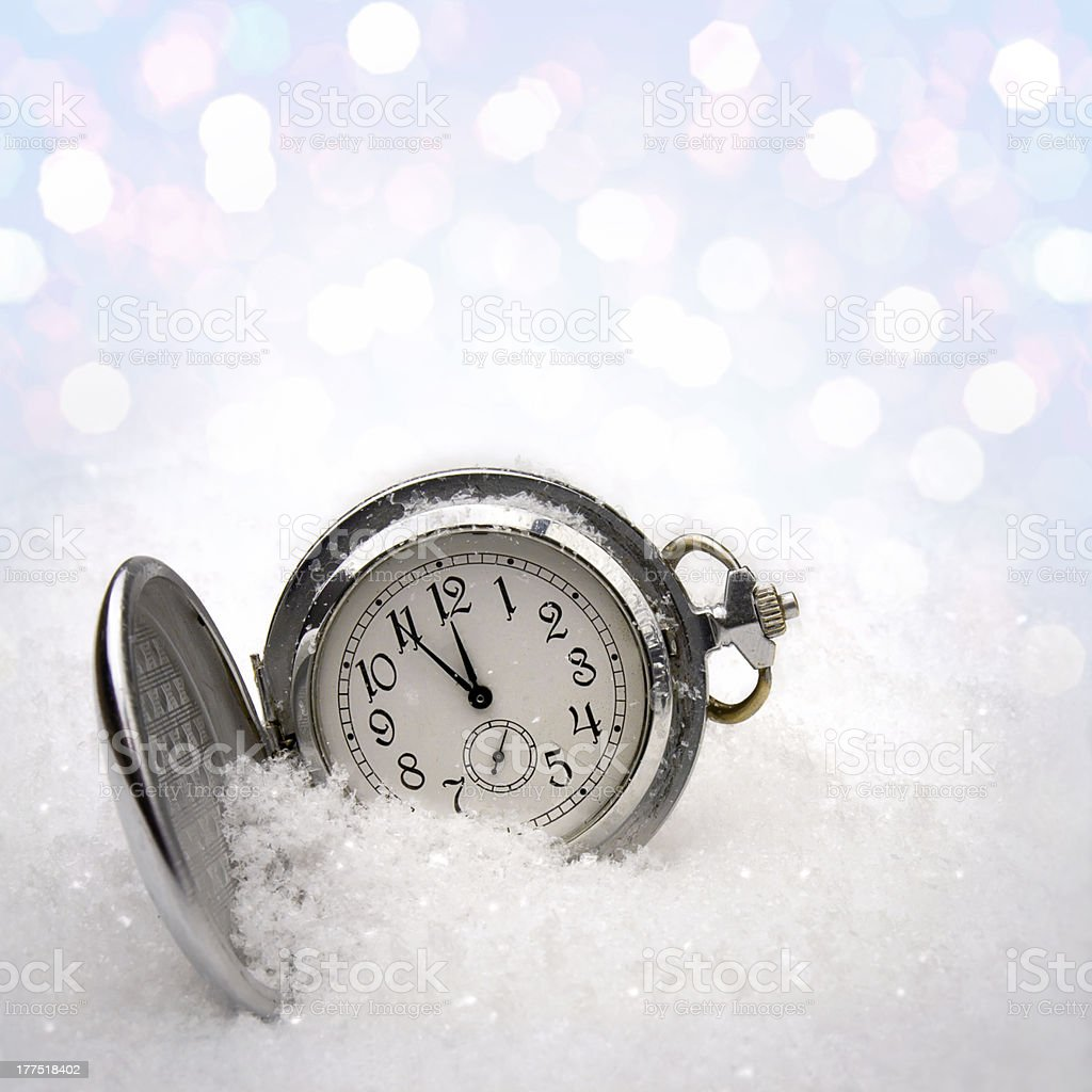 Watch lying in the snow royalty-free stock photo