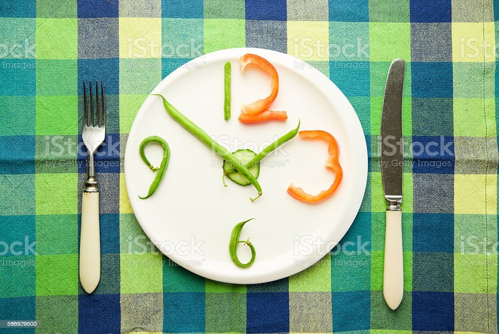 Watch made from vegetables are on the plate stock photo