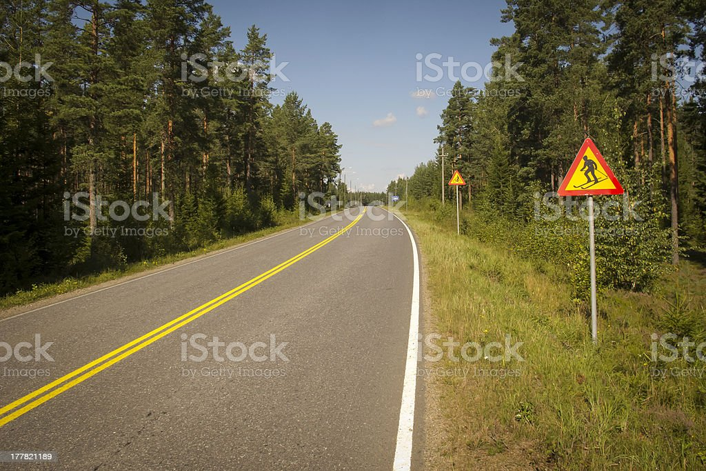Watch out for skiers and cyclists signs royalty-free stock photo