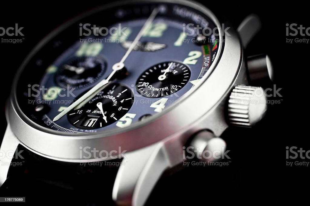 A watch showing a time of 7 o'clock stock photo