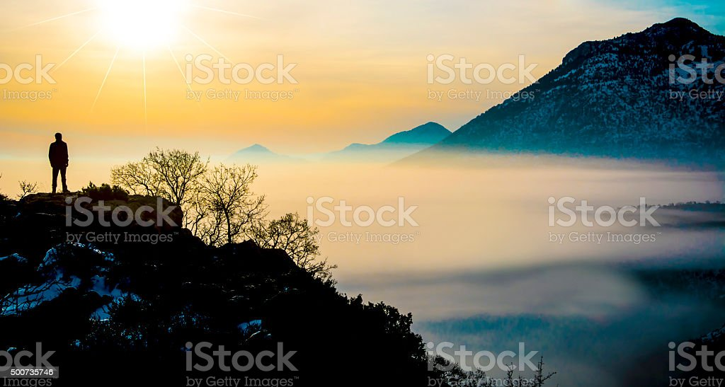 watch the rising sun from the summit stock photo