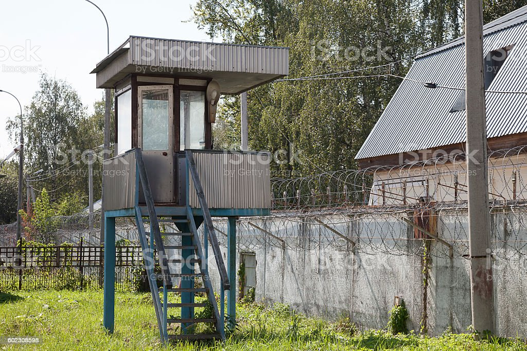 Watch tower in abandoned prison stock photo