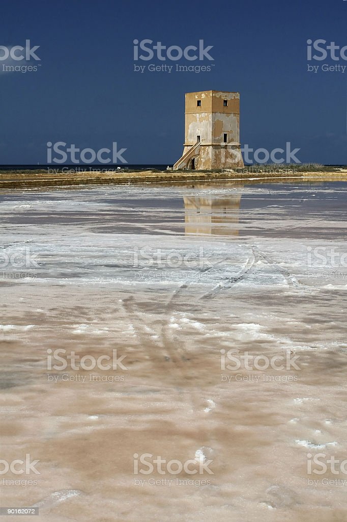 Watch Tower Reflected in Salt Pond, Sicily royalty-free stock photo