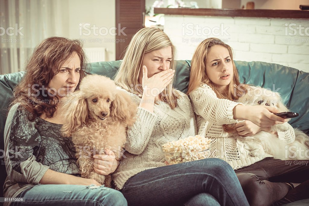 Watch TV at home. stock photo