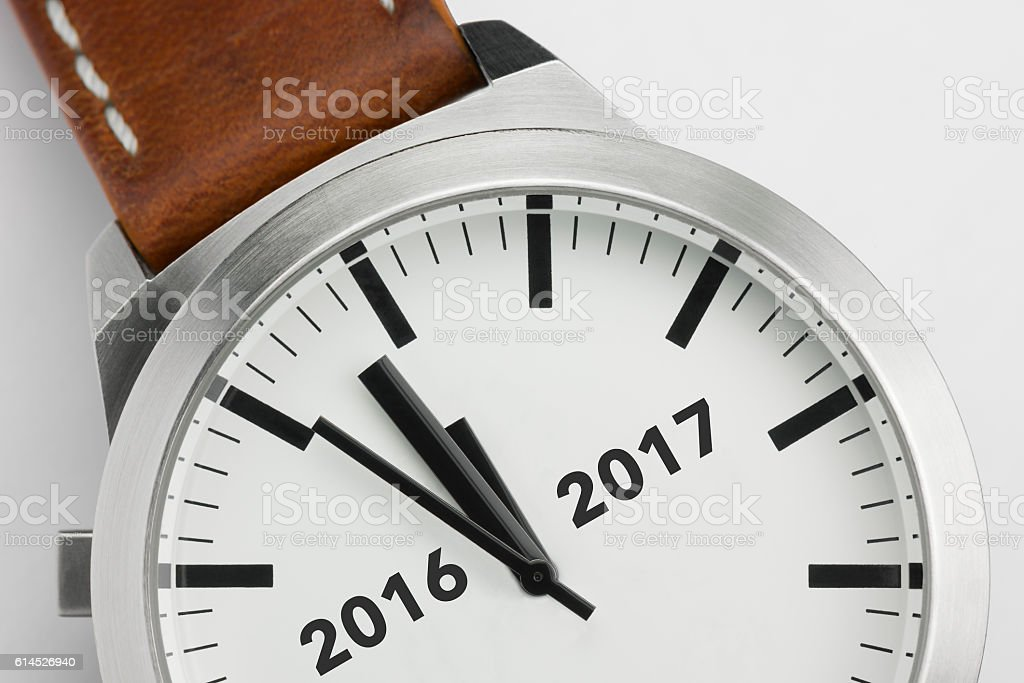 Watch with analog conceptual visualization of the turn of the year. stock photo