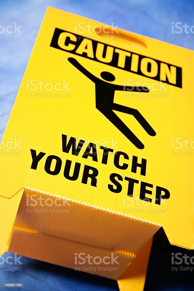 watch your step sign royalty-free stock photo