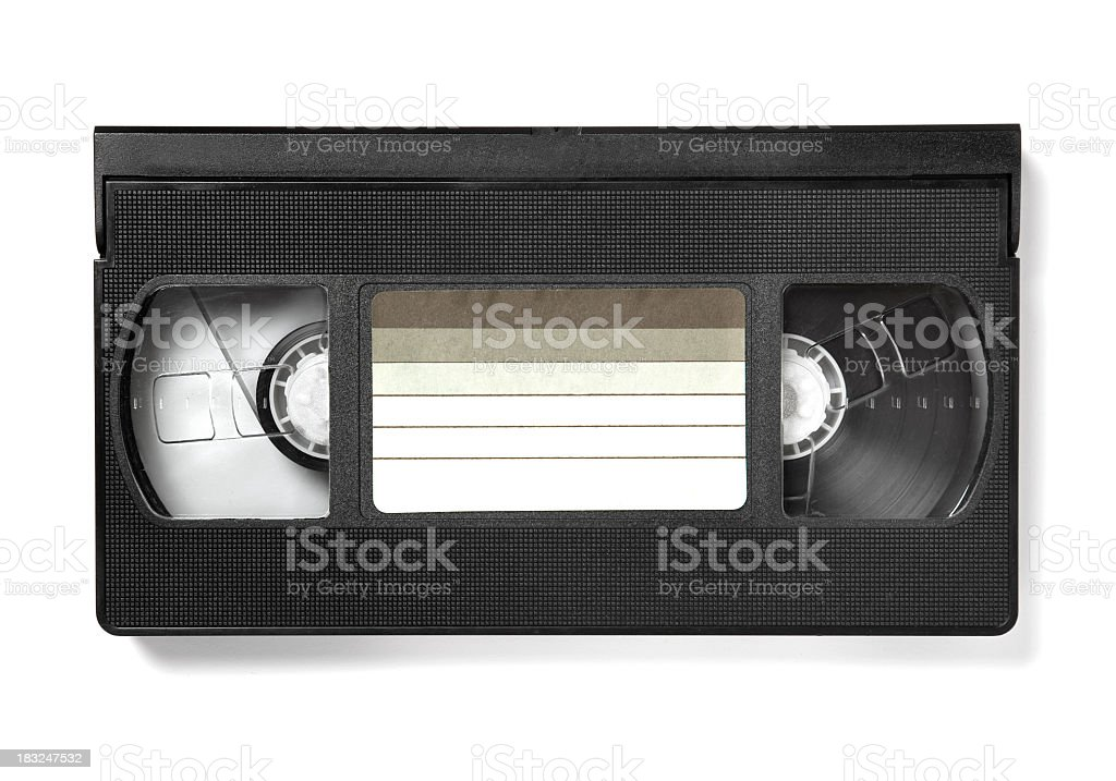 A watched VHS tape with a blank label stock photo