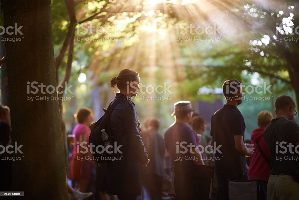 Watching a band beneath the sun stock photo