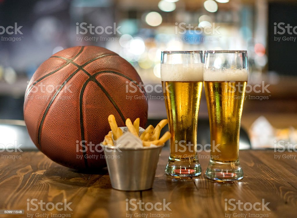 Watching a basketball game at a sports bar stock photo