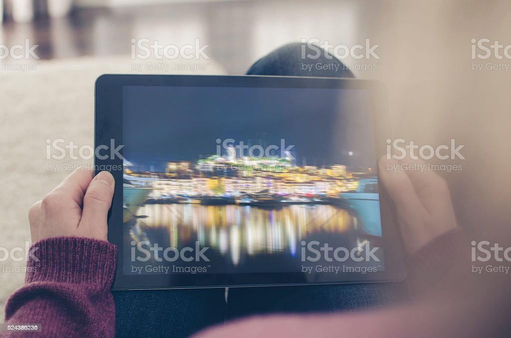 Watching a film on a digital tablet computer stock photo