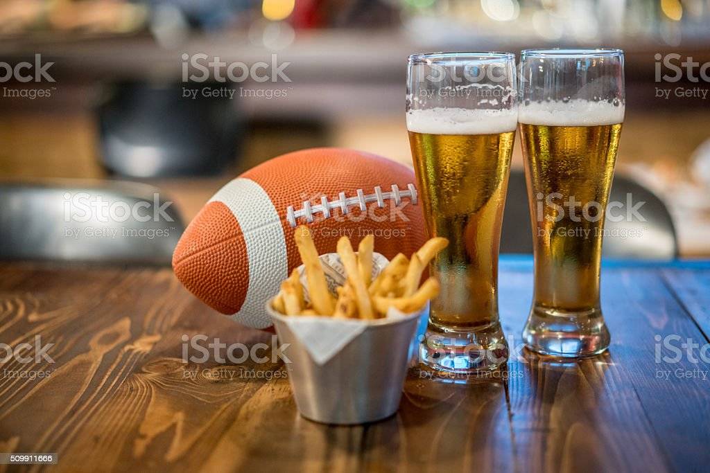 Watching a football game at a sports bar stock photo