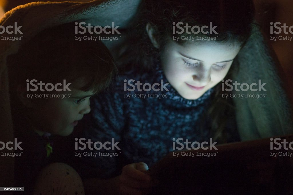 Watching a Movie in Bed stock photo