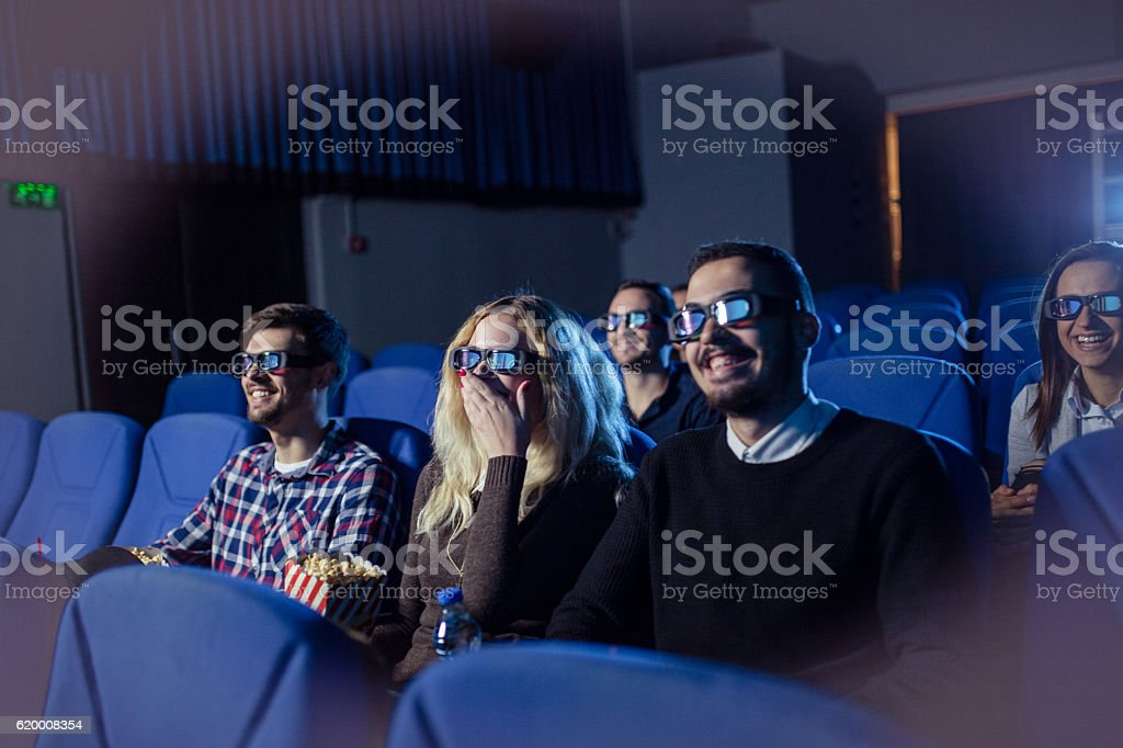 Watching a movie in cinema stock photo