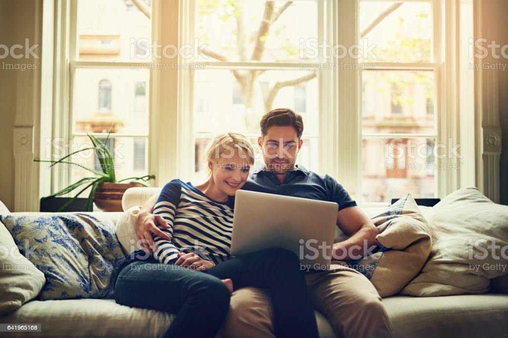 Watching a movie on the sofa is good enough stock photo
