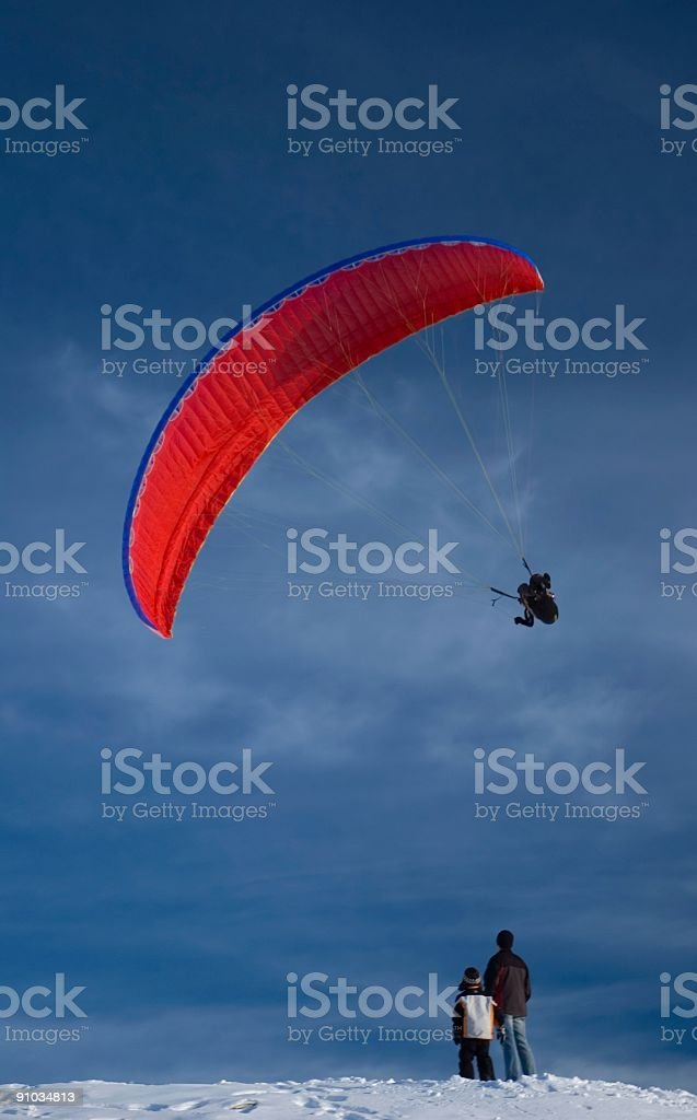 Watching a Paraglider stock photo