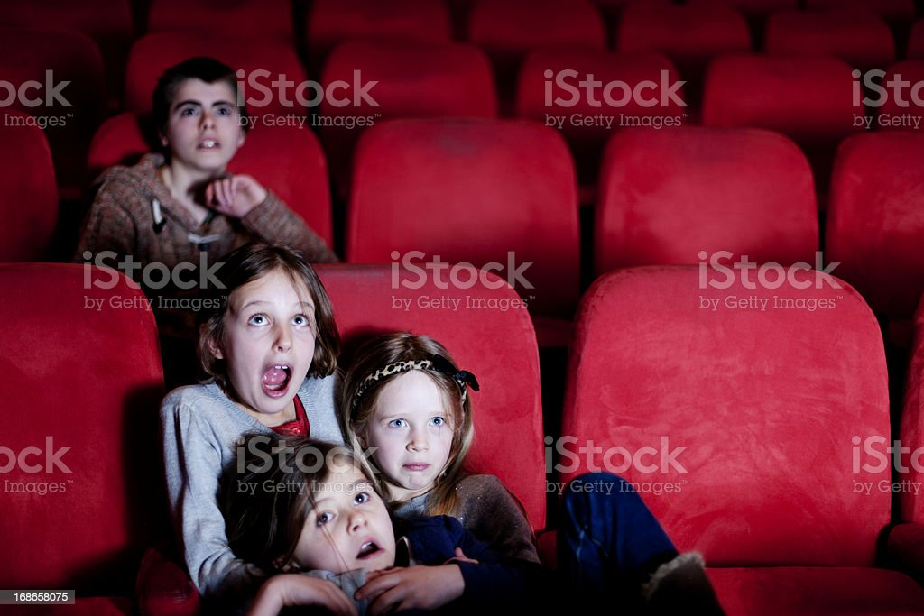Watching a scary movie stock photo