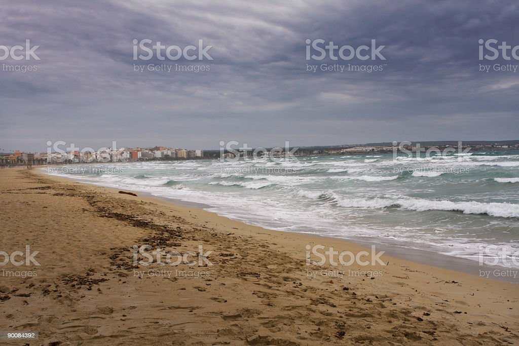 Watching a storm rolling into beach, Mallorca Spain royalty-free stock photo