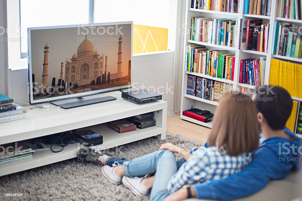 Watching a travel channel stock photo