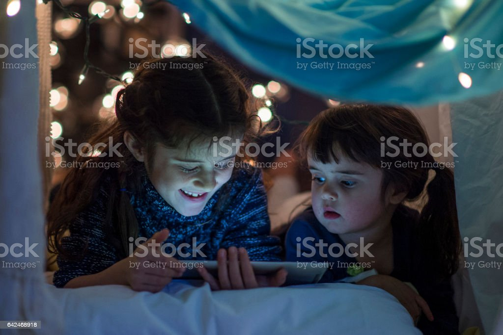 Watching a Video in Bed stock photo