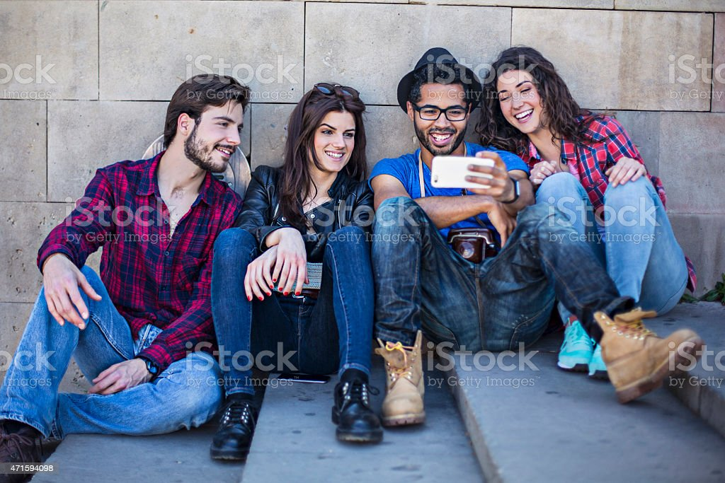 Watching a video on the mobile phone stock photo