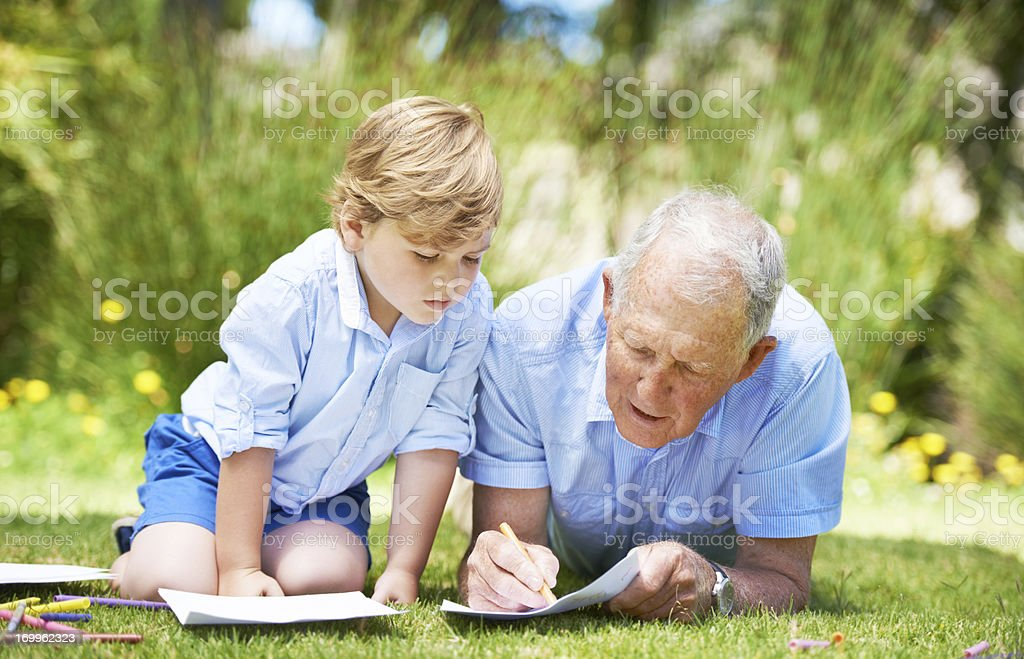 Watching and learning from his grandpa royalty-free stock photo
