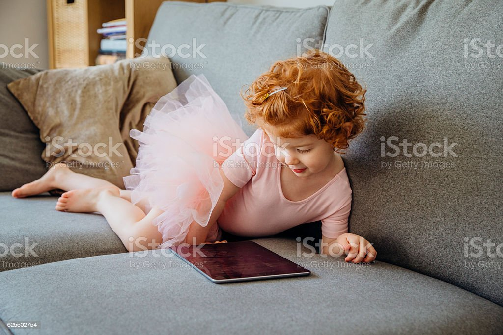 Watching Ballet Videos stock photo