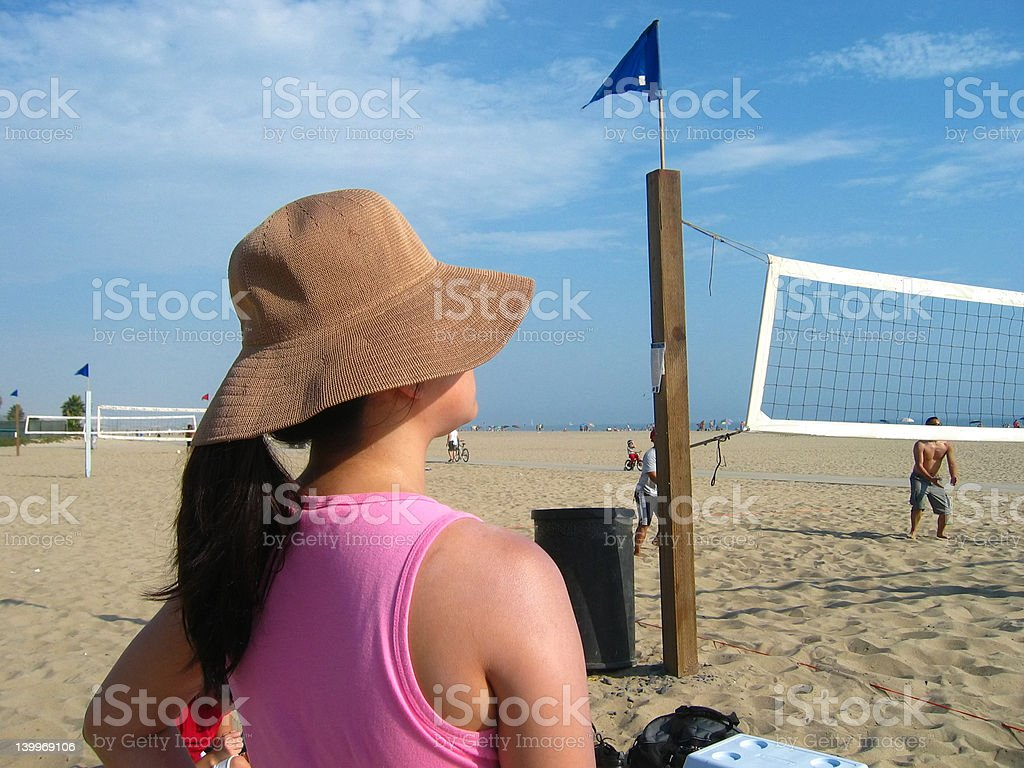 Watching beach volleyball royalty-free stock photo