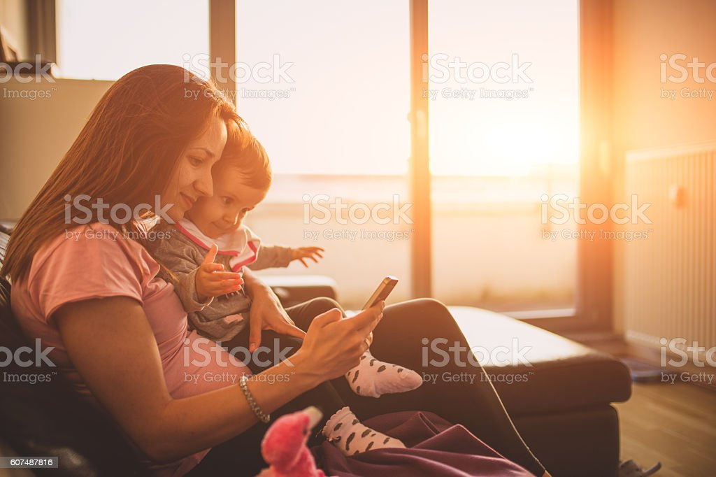 Watching cartoons on the phone stock photo