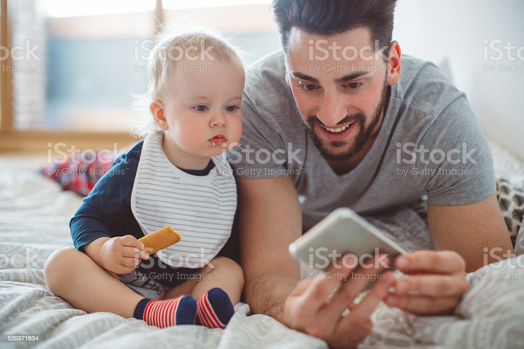 Watching cartoons together stock photo