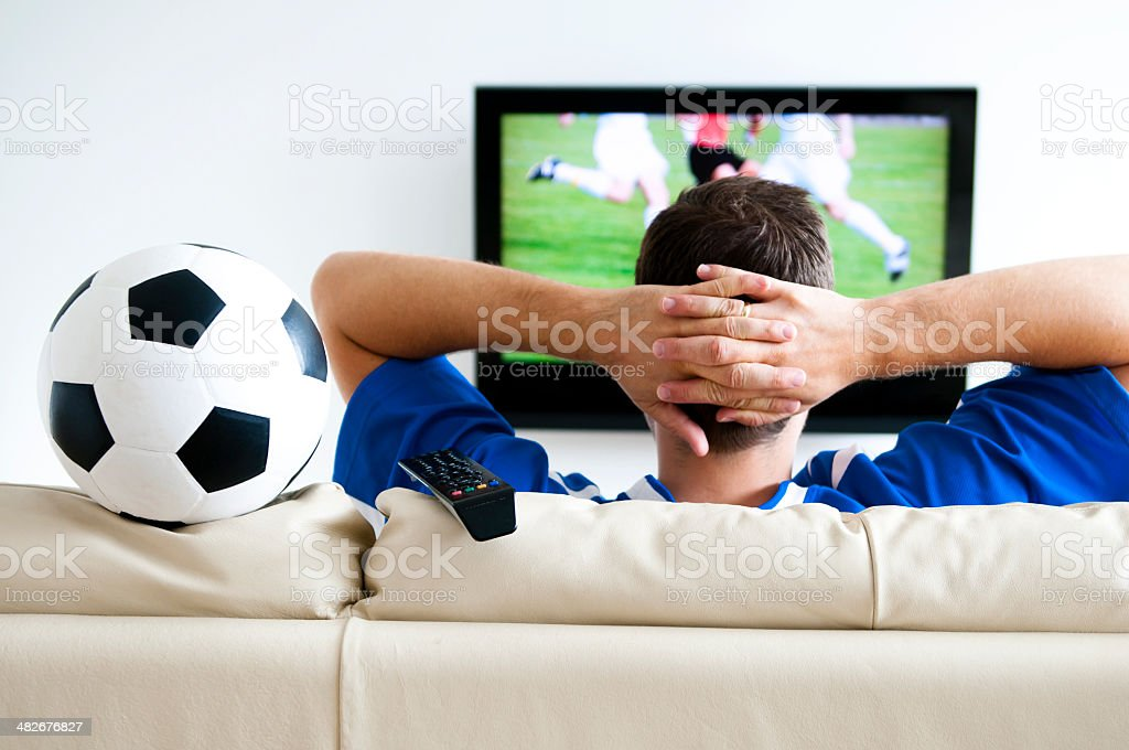 Watching football on tv at home royalty-free stock photo