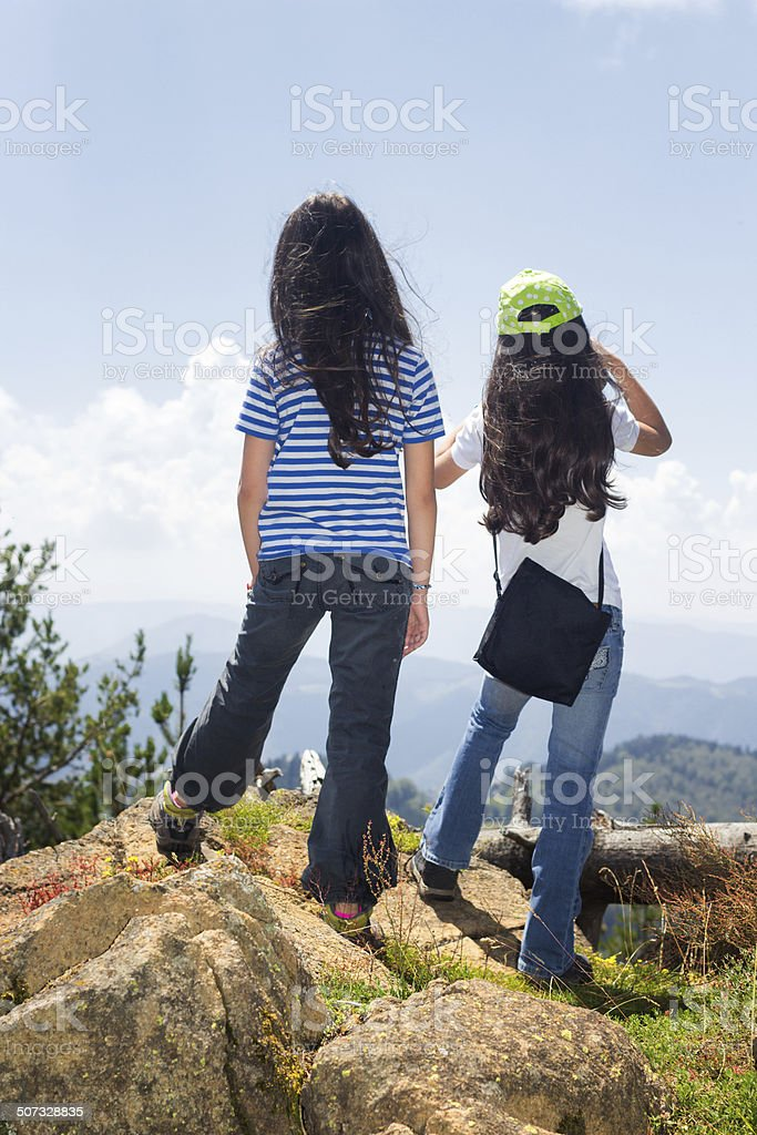 Watching from the top of  mountain stock photo
