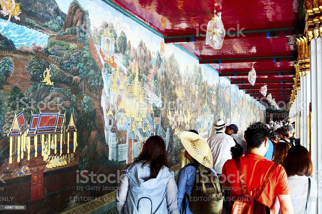 Watching history in Wat Phra Kaeo royalty-free stock photo