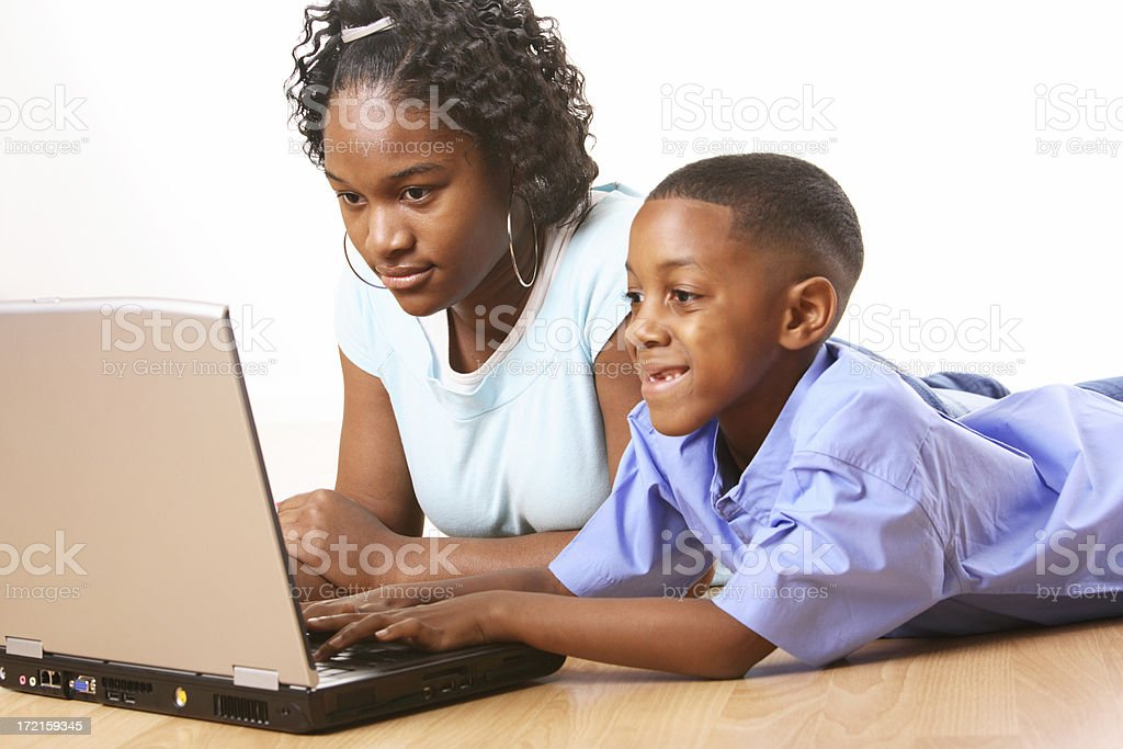 watching little brother on the Computer royalty-free stock photo