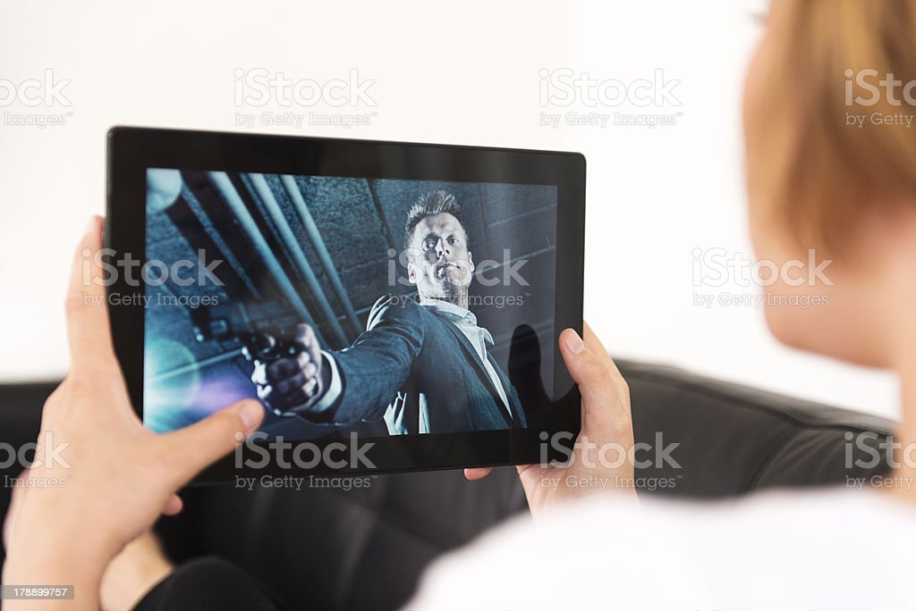 Watching movie on a digital tablet royalty-free stock photo