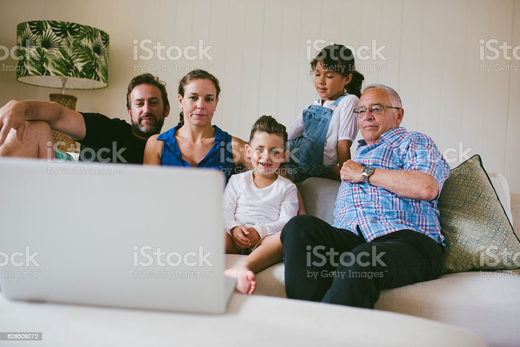 Watching old family videos together stock photo