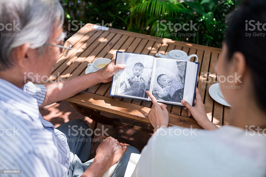 Watching photos of baby boy stock photo