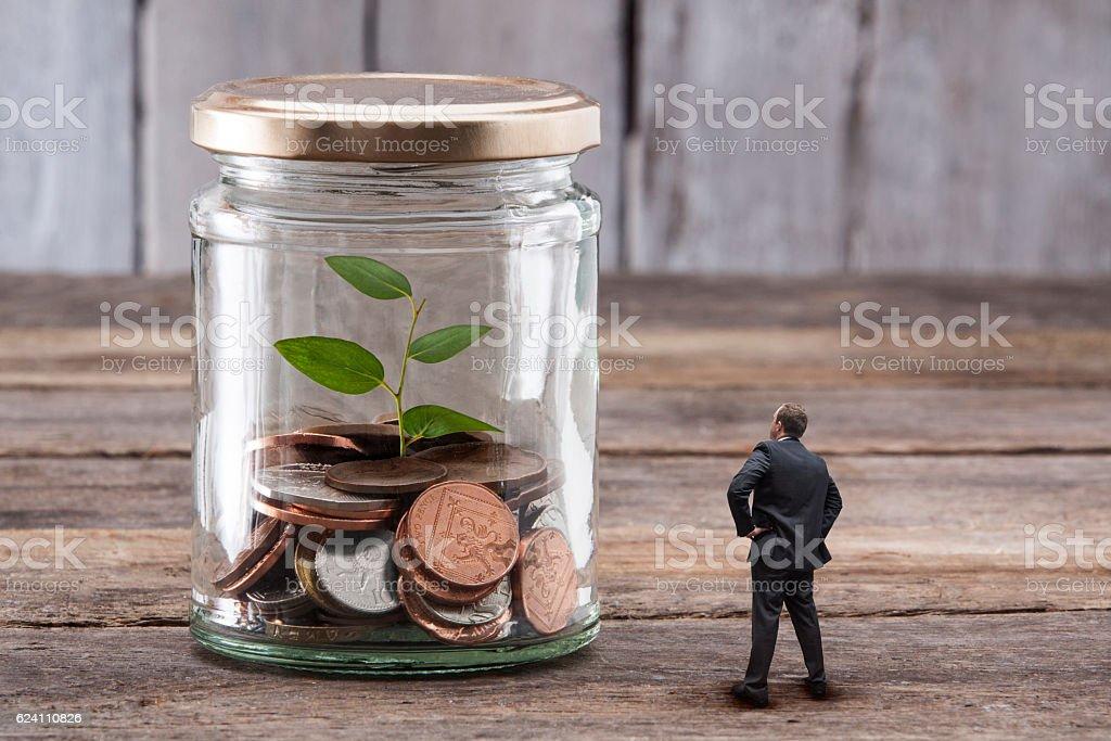 Watching Savings Grow stock photo