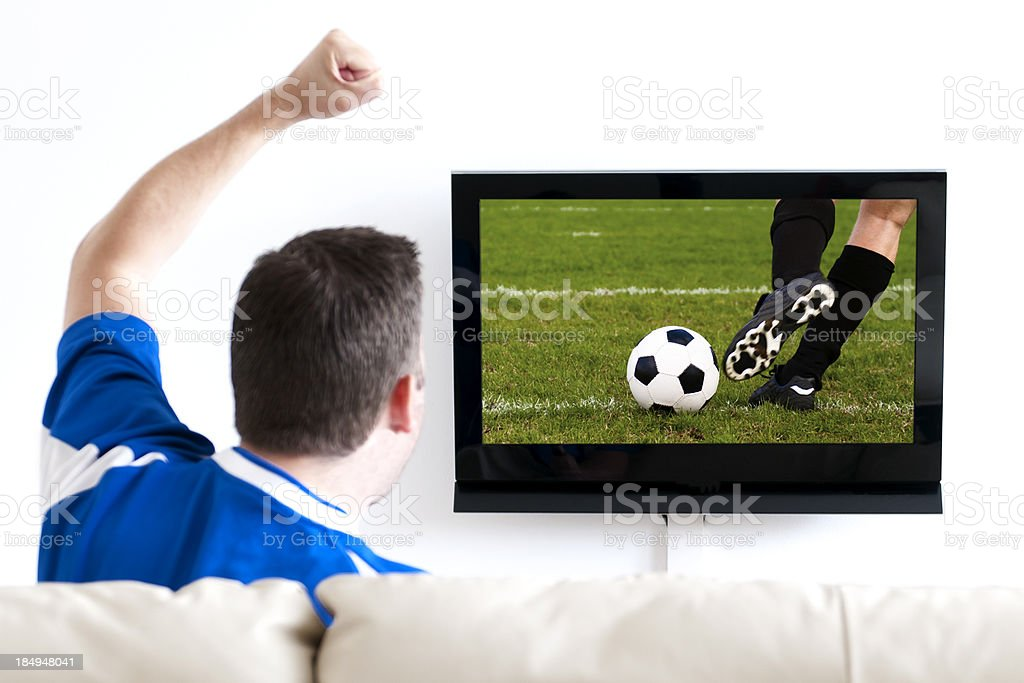 Watching soccer on tv from the sofa royalty-free stock photo