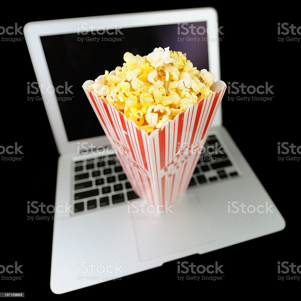 Watching Streaming Movies with Popcorn royalty-free stock photo