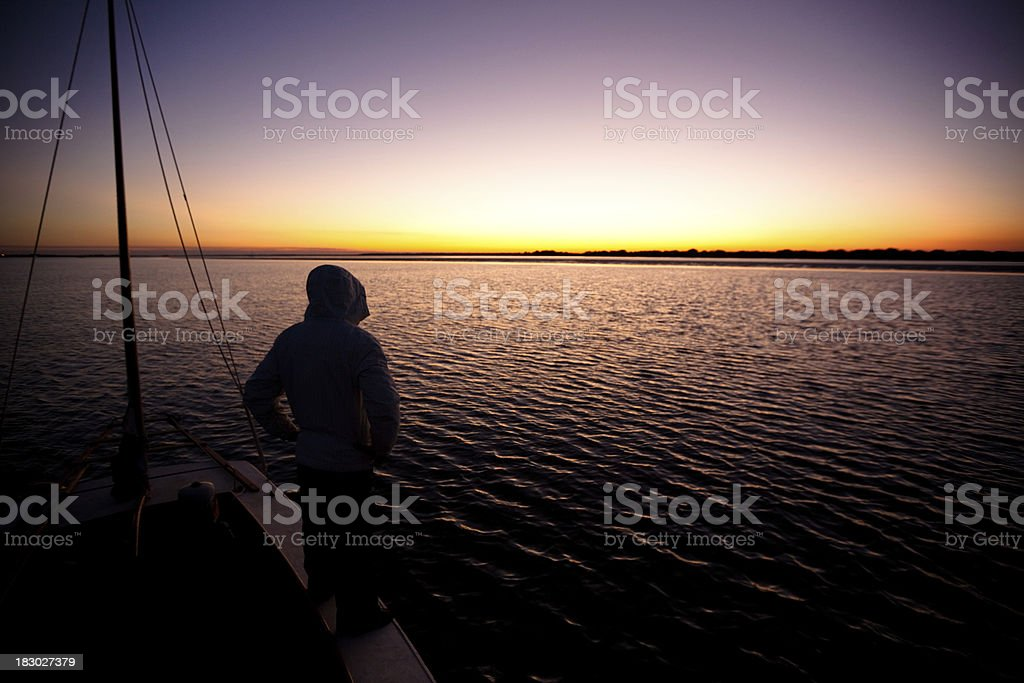 Watching sunset from a sailboat royalty-free stock photo