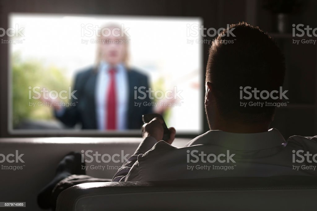Watching Television on Couch stock photo