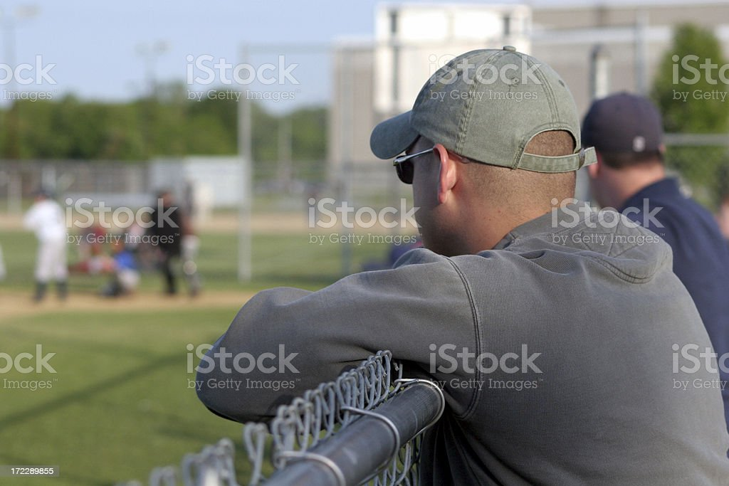 Watching the baseball game stock photo