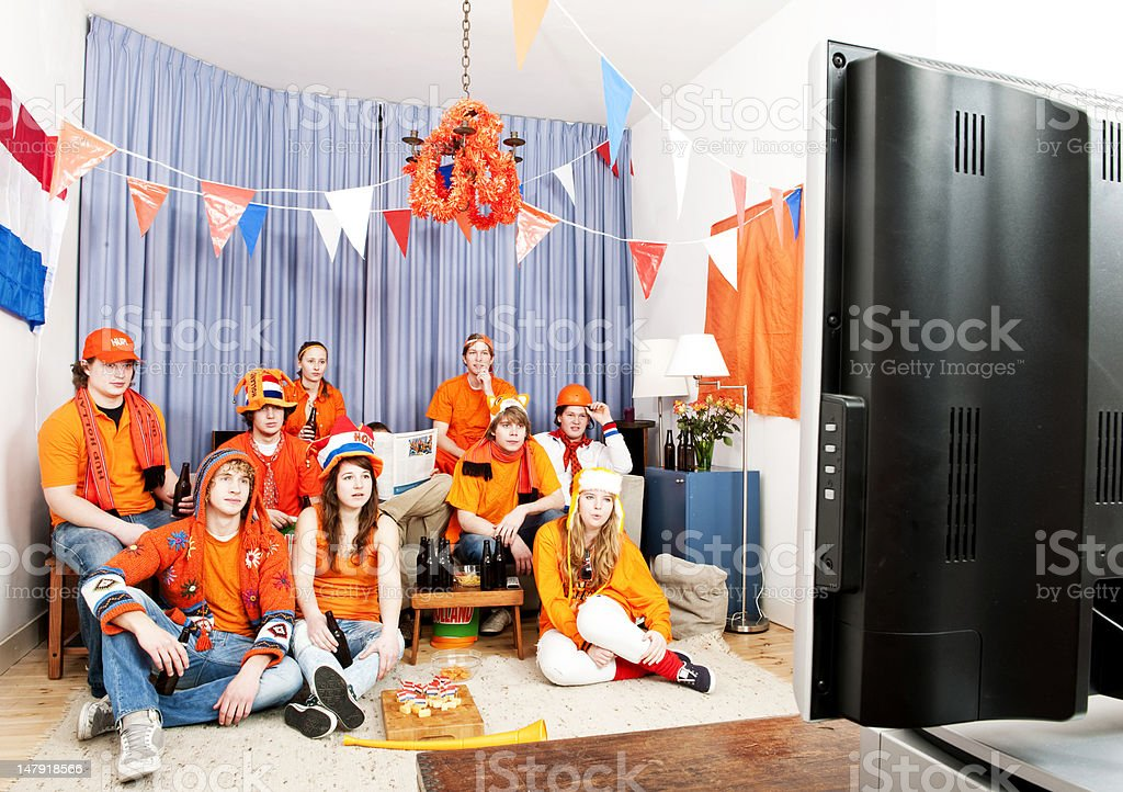 Watching the game at home royalty-free stock photo