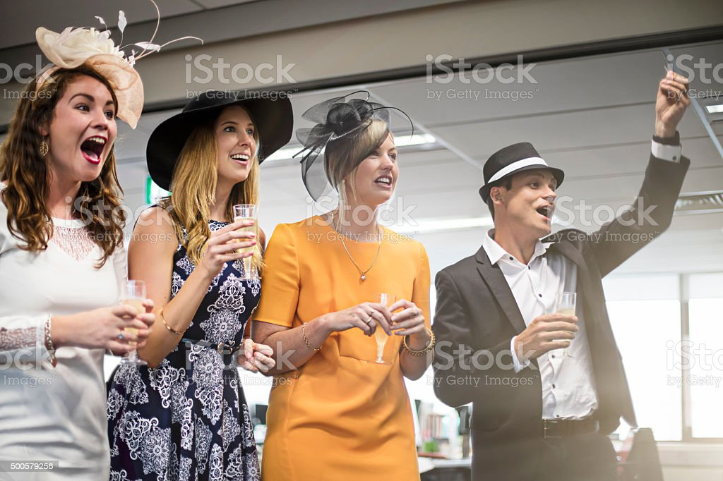 Watching the Melbourne Cup race in the offfice stock photo