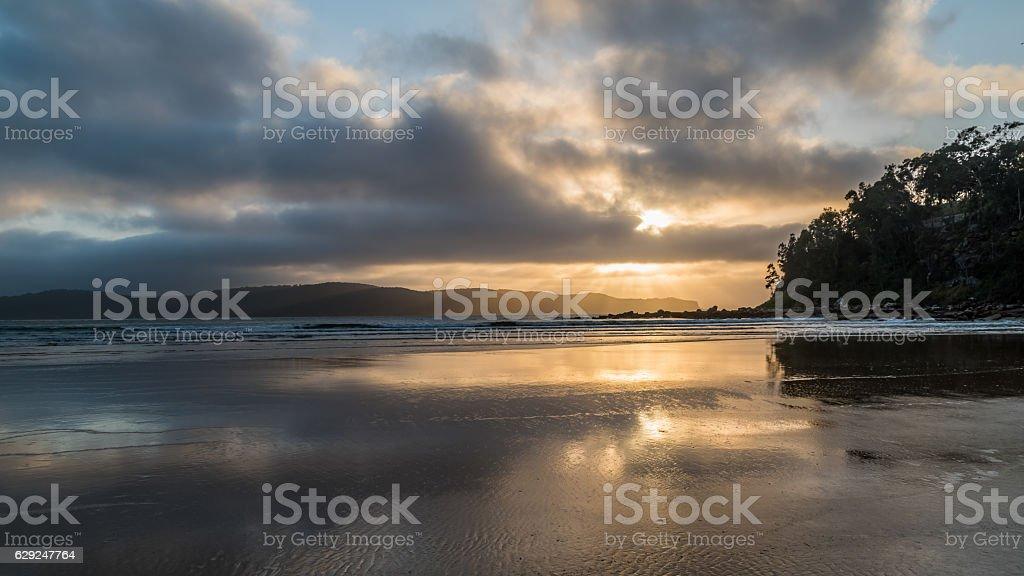 Watching the sunrise from Umina Point stock photo