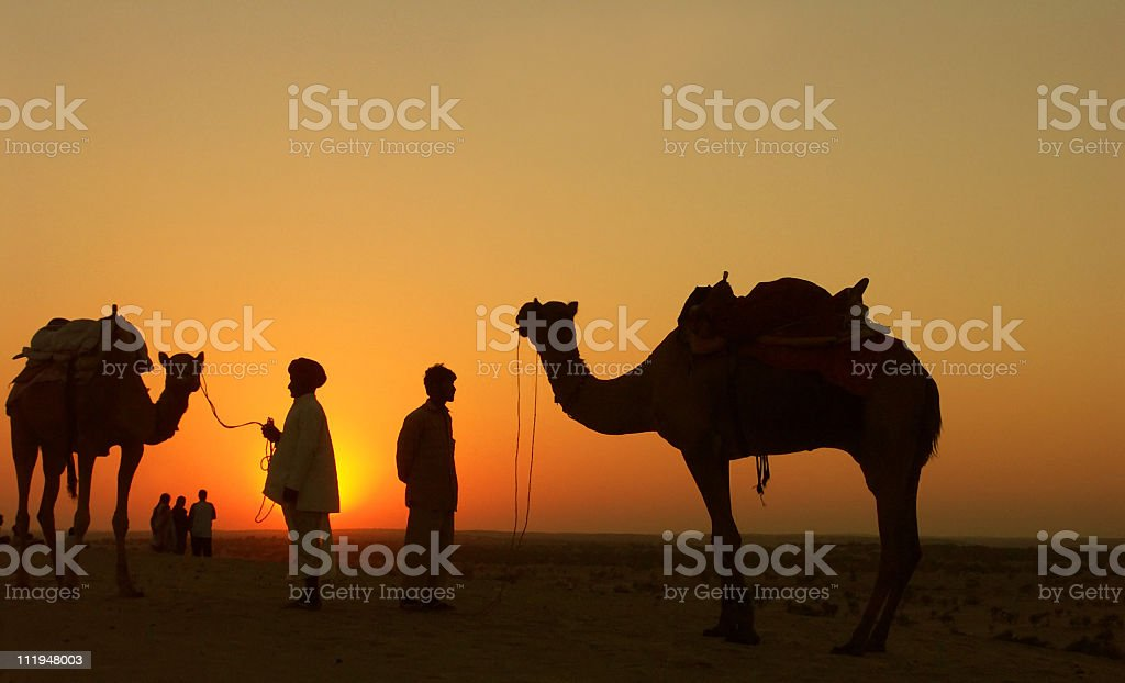 Watching the sunset at Sam Dunes  near Jaisalmer,Rajasthan,India royalty-free stock photo