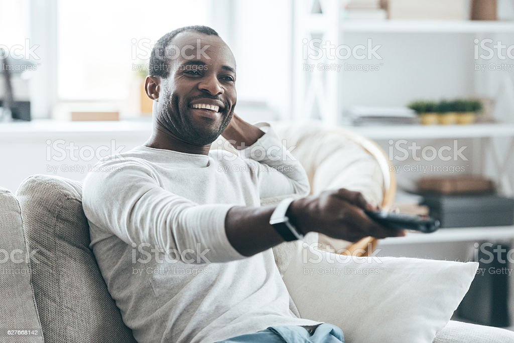 Watching TV at home. stock photo