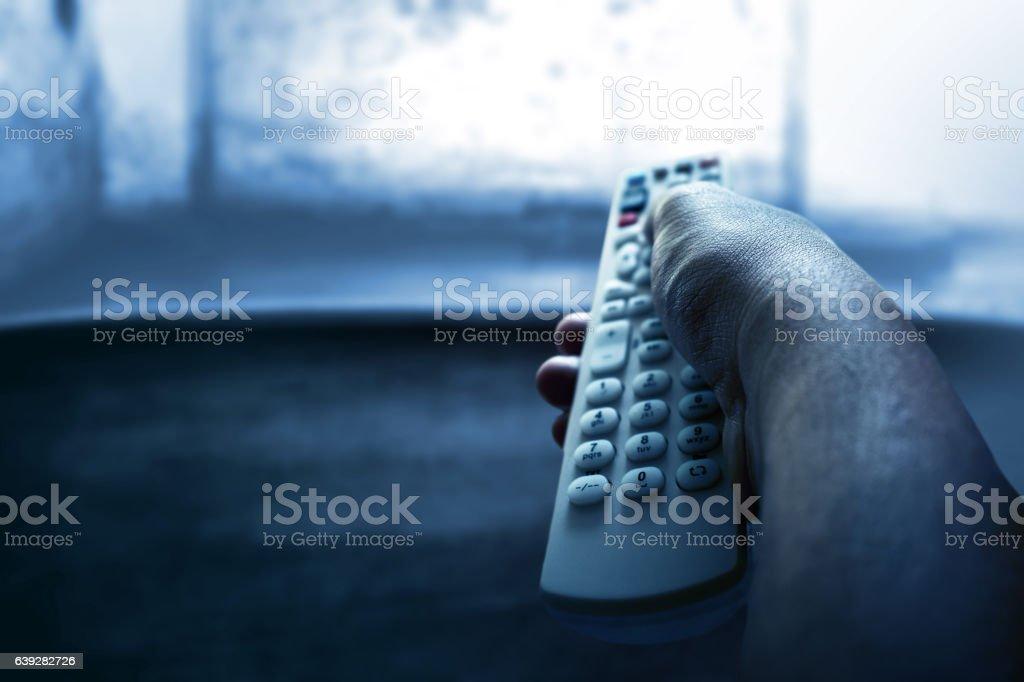 Watching tv at night stock photo